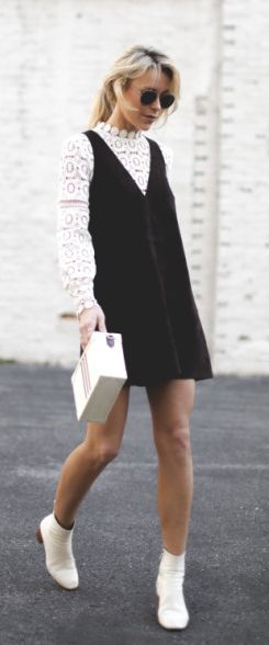 Suede dress trend + Mary Seng + understated look + suede V neck pinafore + lace top + white Chelsea boots.   Dress: Free People, Top: Self Portrait, Boots: Isabel Marant.