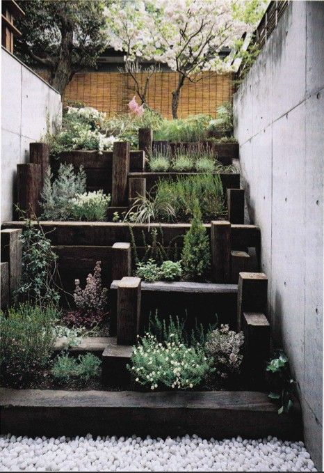 Small city garden: using railway sleepers as steps ...