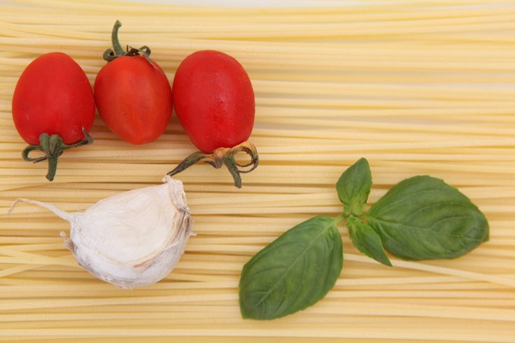 Spaghetti with 'piennolo' tomatoes and basil  Serves two  200g/7oz spaghetti 250g/9oz 'piennolo' tomatoes, cut into quarters lengthwise, not peeled 2 tablespoons extra virgin olive oil I unpeeled clove garlic Handful of fresh basil leaves, roughly torn Salt to taste