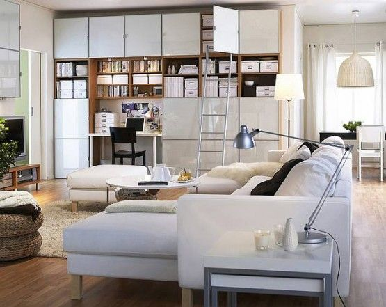 modern family room - Google Search  ikea? cabinets, floor to ceiling storage, sectional