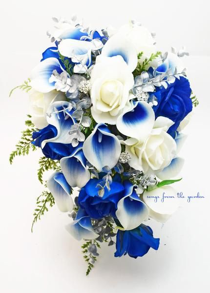 This cascade bouquet of blue and white Real Touch roses, Real Touch royal blue Picasso calla lilies, silver accents and rhinestones can be yours to have and to hold on your wedding day! I can create i