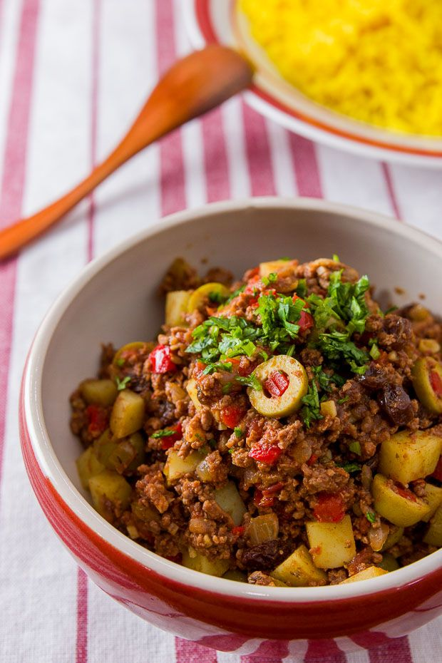 Cuban-Style Picadillo is a beef hash with potatoes, raisins, and olives. Redolant of warm spices like cumin and cinnamon, it's easy to make and delicious.