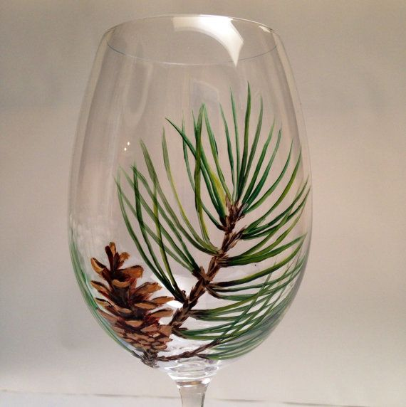 These hand painted wine glasses have a detailed painting of a pine cone and bough. This glass looks great in any setting, but I can imagine it
