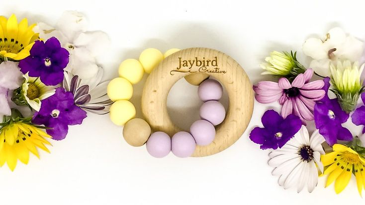 Jaybird Creative Classic Teether in lavender and butter. Made from beech wood and silicone