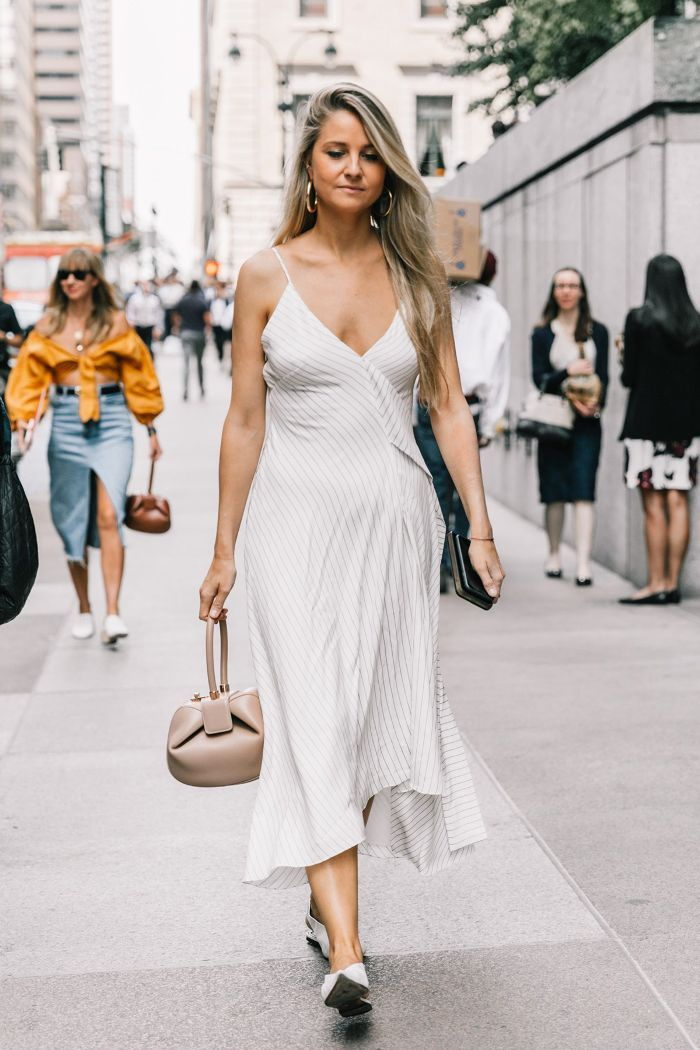 Layered dresses—whether tiered or hemmed with ruffles—are what we're head over heels for right now. See and shop the looks we love.