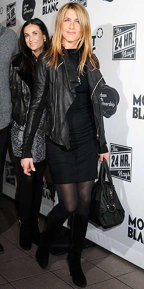 With pal Demi Moore Jennifer Aniston makes a stylish statement in a body-conscious black minidress topped with a motorcycle jacket, accented with knee-high boots while heading to the after party for The 24 Hour Plays on Broadway 2009.