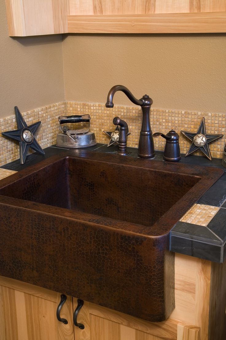 Dark farmhouse sink oil rubbed bronze fixtures glass tile counters and a co