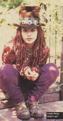 Wouldn't be the 90's without a Slash hat... Linda Perry from the 4 Non Blones with her dreadies
