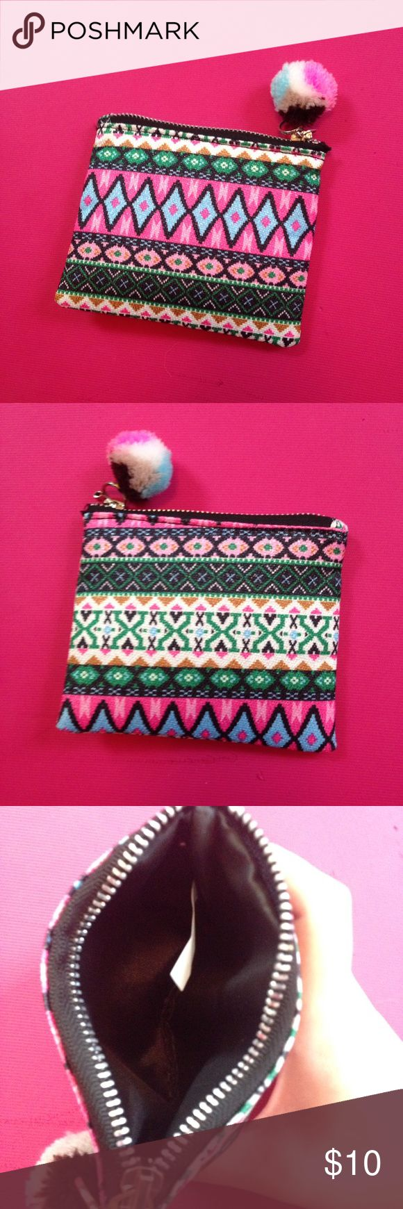 NWOT Tribal Aztec Print Wallet This little zip up coin purse is in perfect condition and never has been used.  Bought at a local boutique. Not Free People. The print is fun and trendy. Love this little guy! Bundle up, make an offer, and feel free to ask any questions 💕🛍 Free People Bags Wallets