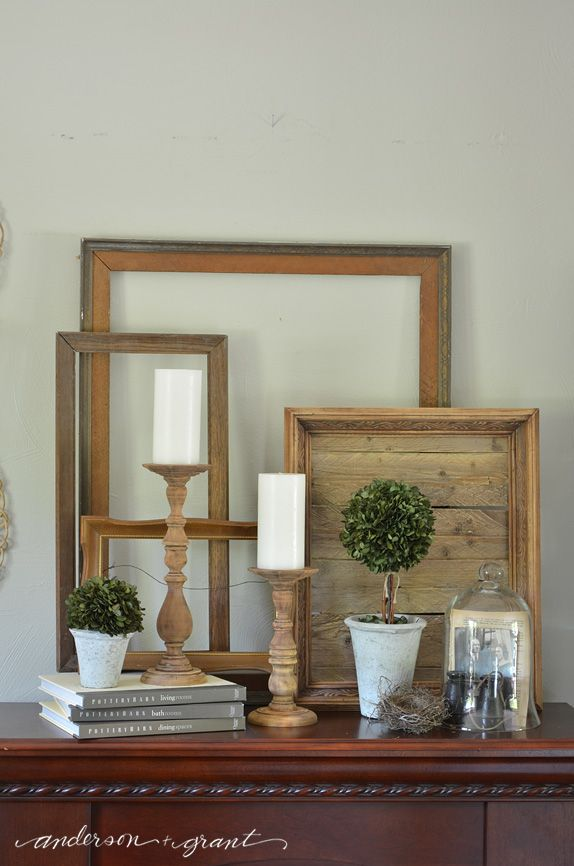 Decorating with random wood frames provides a beautiful backdrop for any display.  |  www.andersonandgrant.com