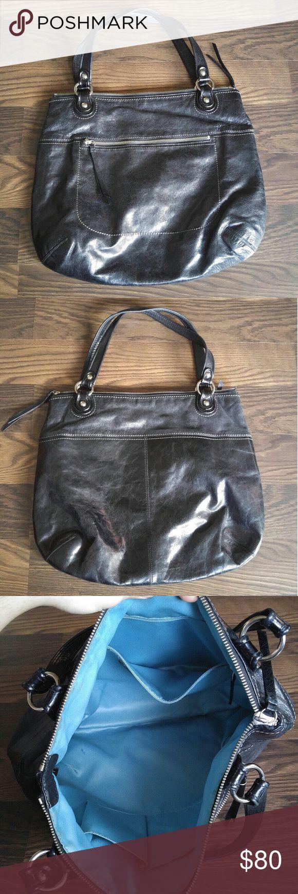 Coach Hobo Bag Coach glazed black leather hobo bag. Has one exterior pocket and light blue interior. Coach Bags Hobos