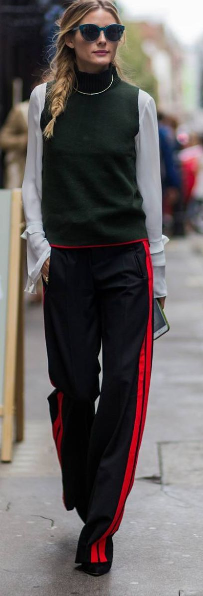 Who made Olivia Palermo's red stripe pants, green sweater vest, and blue cat sunglasses?