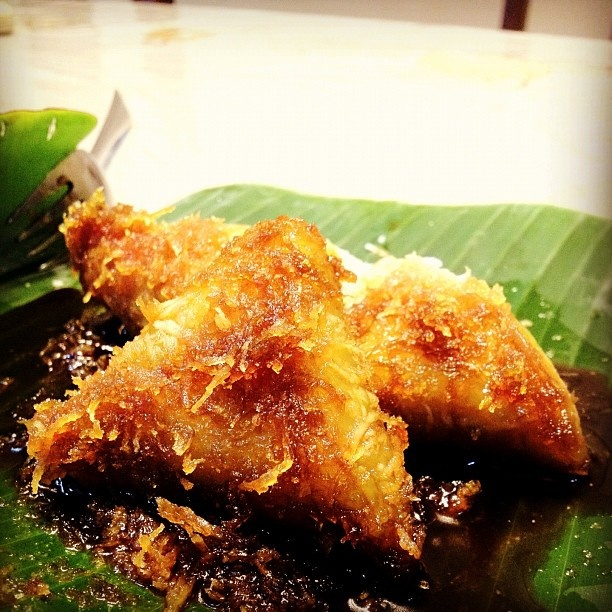 Lupis  always sticky rice drizzled with brown sugar syrup plus shredded coconut