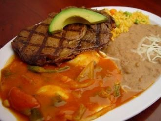 Huevos A La Rodeo :One juicy beef steak and two eggs served on a corn tortilla topped with salsa and avocado. Served with beans, rice & tortillas from Pico Pica Rico Restaurant in Los Angeles #Food #Breakfast #Restaurant forked.com