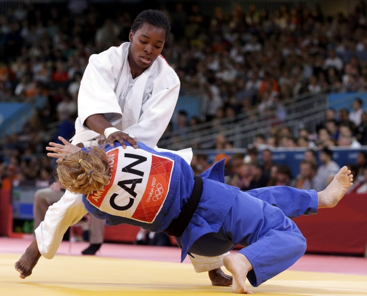 France's Audrey Tcheumeo fights with Canada's Amy Cotton (blue) during their women's -78kg elimination round of 32 judo match at the London 2012 #Olympics Games. Reuters Photo