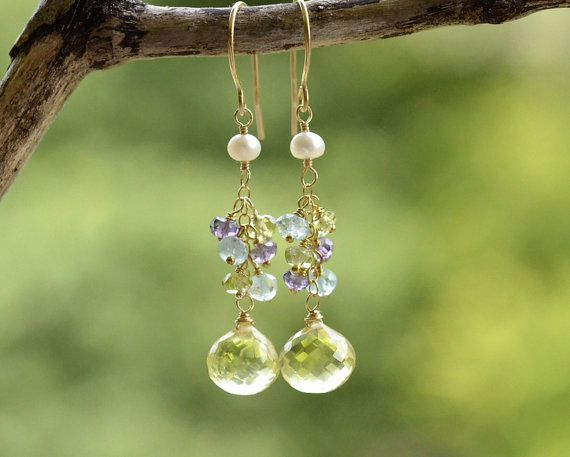A pair of sparkling microfaceted lemon quartz onion briolettes were adorned by clusters of aquamarine, peridot and amethyst rondelles. They were suspended under freshwater pearls. Very fresh and feminine, best for summer wear. The earhooks were hand forged by me. The earrings measure 1