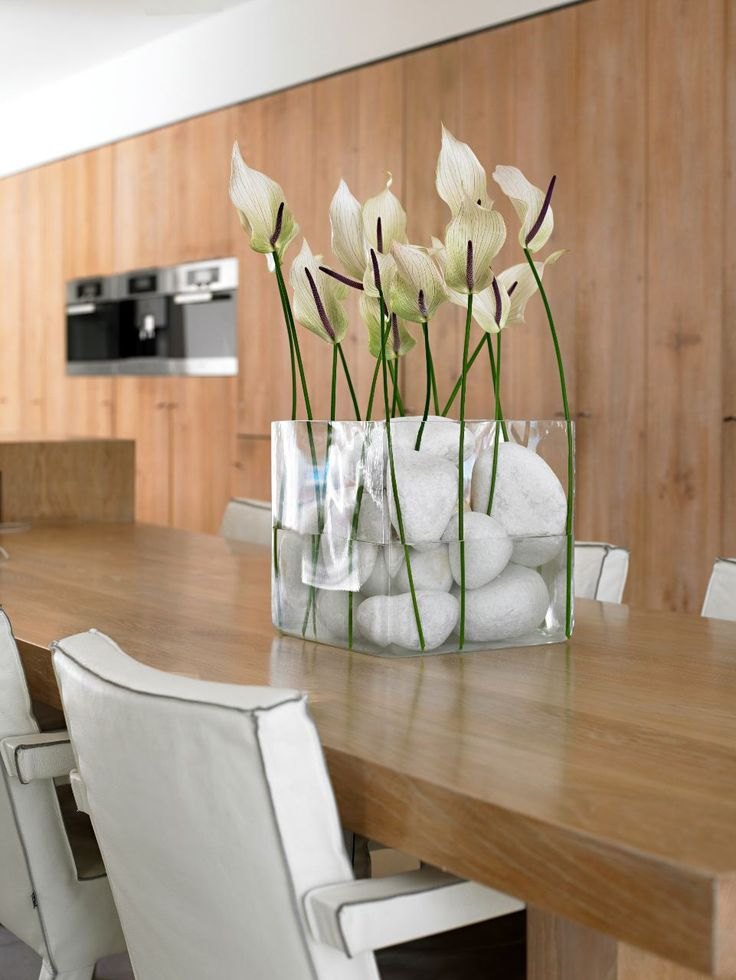 Flower decoration with Anthurium. Nice on a big kitchen table!