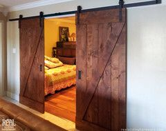 29 best sliding barn doors images on pinterest sliding doors way to hide a guestroom barn door installations rustic interior doors other metro real sliding hardware planetlyrics Gallery