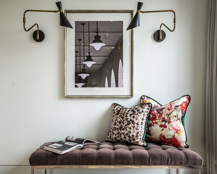 Inspired by a mid-century Italian pharmacy lamp, these aged brass swing-arm wall lamps by Julian Chichester add an elegant vintage style to the design befitting these trendy East London apartments.