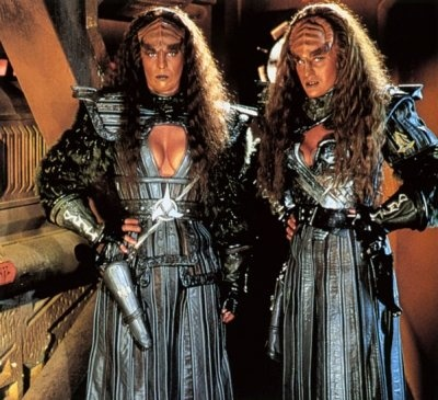 "Lursa and B'Etor from the House of Duras. The Duras sisters were responsible for the start of the Klingon Civil War. TNG: (3), DS9: ""Past Prologue"", Star Trek Generations"