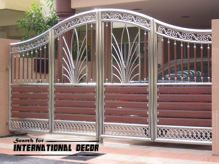 Modern sliding iron gate designs uk sliding iron gates international decor gates doors and for Wooden main gate design for home