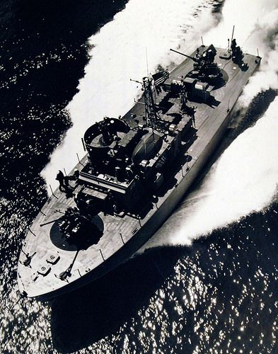 """Navy Demonstrates New PT Boats. """"PT Boat"""" Aluminum hulled, of Motor Torpedo Squadron I, running at high speed in Chesapeake Bay. The hulls were half-welded and half-riveted. Photograph released April 27, 1951."""