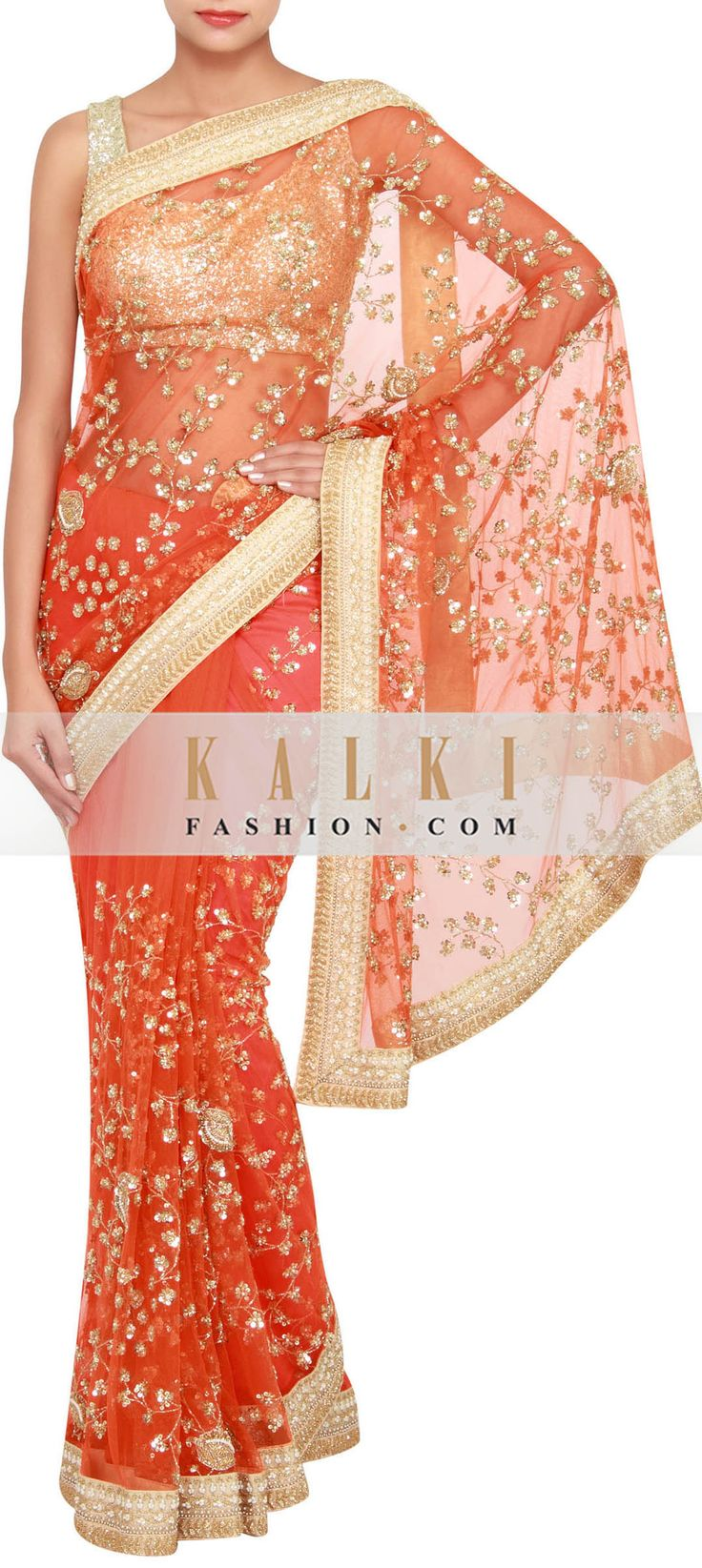 Buy Online from the link below. We ship worldwide (Free Shipping over US$100) http://www.kalkifashion.com/orange-net-saree-embellished-in-pearl-and-stone-only-on-kalki.html