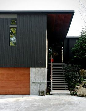 north side siding.  similar in feel to black corrugated paneling virtically oriented paired with concrete.