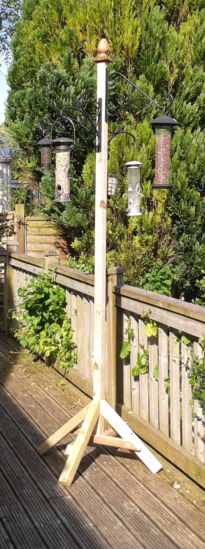 Bird feeding station – made using treated timber and wrought iron hanging basket hooks.