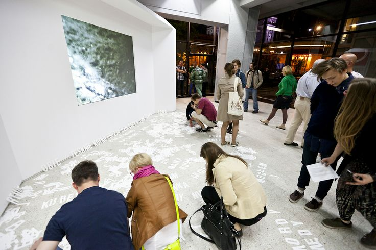 A public interacting with a piece by Ewa Partum.