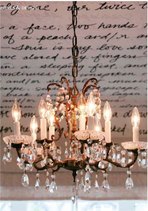 A vintage chandelier illuminates a love poem writ large.         /chandelier in the bedroom is a salvaged 1930s piece, with gorgeous crystal,