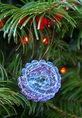 String beads, put in cupcake pan and melt in the oven.  Pretty ornaments.