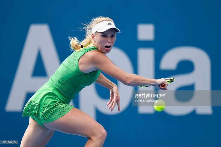 Caroline Wozniacki of Denmark plays a backhand shot in her first round match against Monica Puig of Puerto Rico during day two of the 2017 Sydney International at Sydney Olympic Park Tennis Centre on January 9, 2017 in Sydney, Australia.