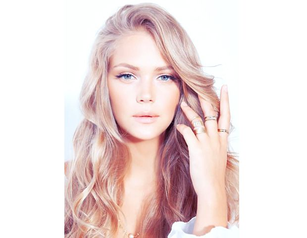 @Byrdie Beauty - A matte peach color on your lids and cheeks perfectly complements tousled, wavy locks.