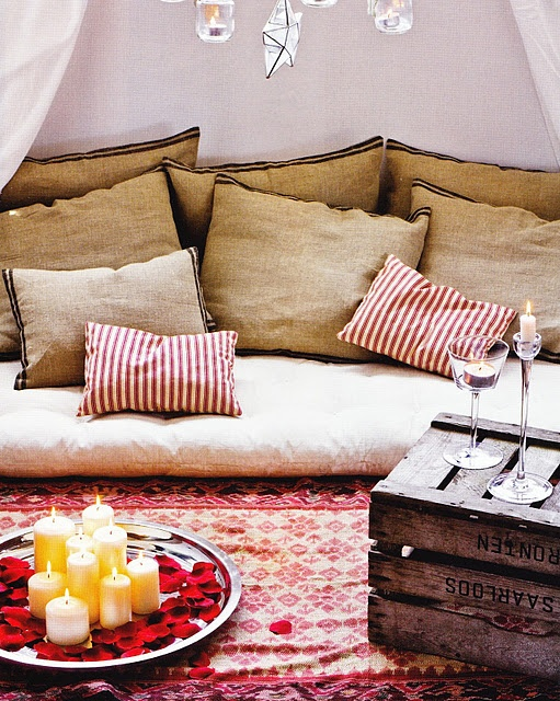 Floor seating is standard in Afghan homes, but the colors and candles make for a nice twist here.