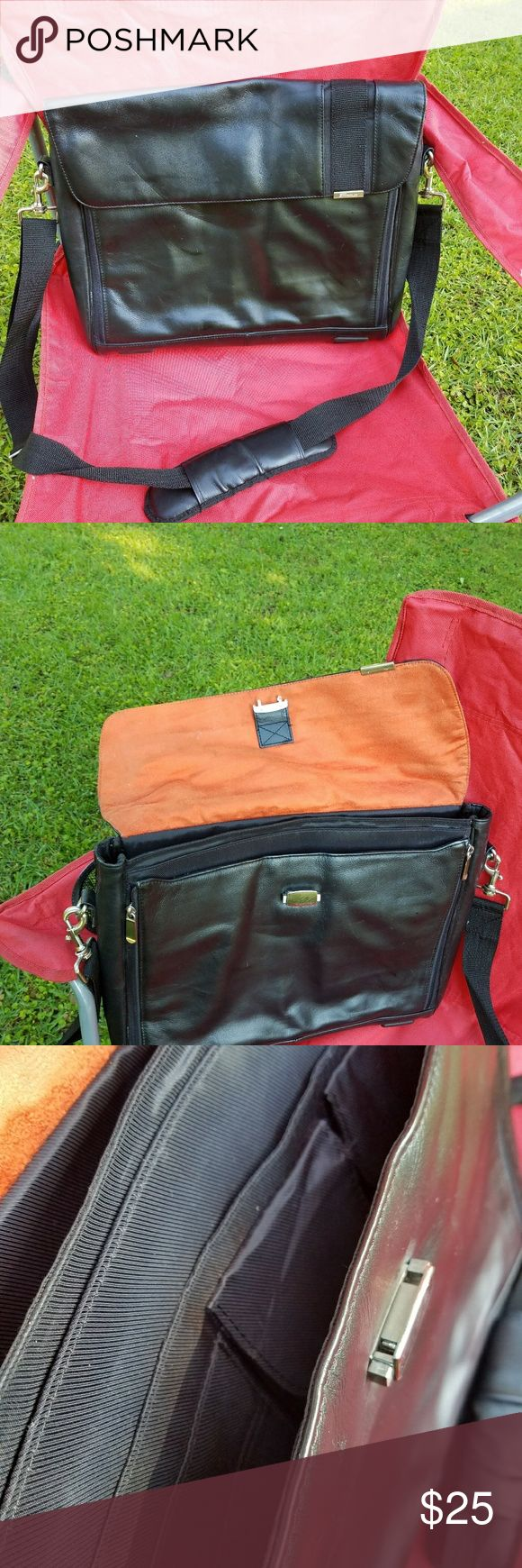 Black Leather  Laptop shoulder bag Black Leather  Laptop shoulder bag...gently used in great condition...many compartments to hold many things...has a very well padded shoulder pad along the shoulder strap...brushed chrome clasp to close the bag Bags Laptop Bags
