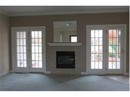 Fireplace flanked with french doors instead of windows for French doors with windows either side