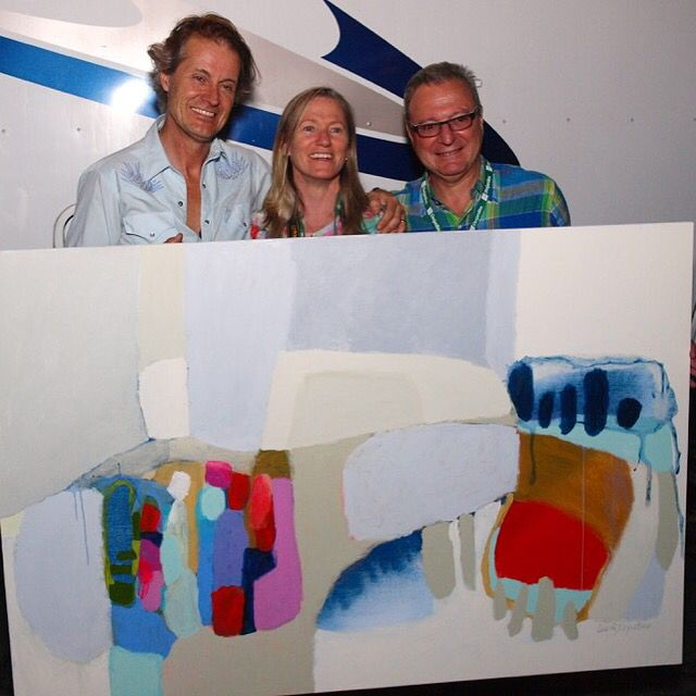 Jim Cuddy (lead singer of Blue Rodeo), myself, and the winning bidder of the auction, Joe Broccolini, holding my completed #painting, after Saturday's Blue Rodeo concert. Photo by : Cassandra Leslie info@c2studios.ca #bluerodeo #bluerodeoconcert #jimcuddy #clairedesjardins #abstractpainting #livepainting #quebecarts