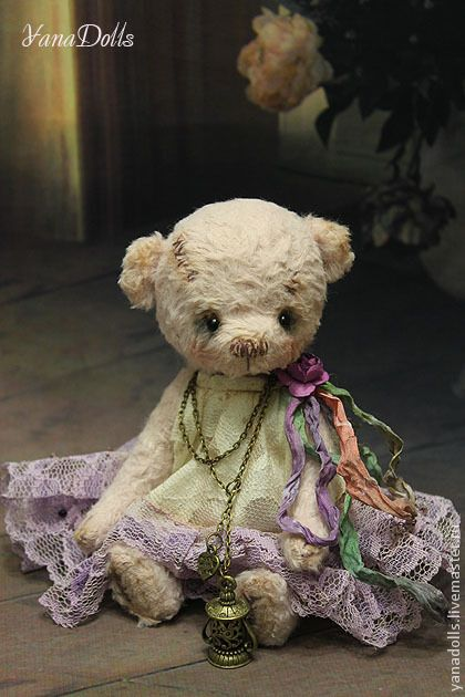 A teddy with lots of laces.