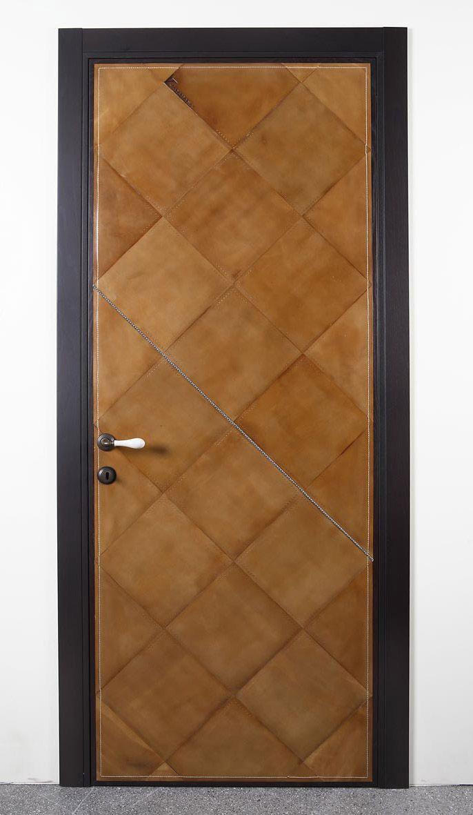 Interior door trim with leather