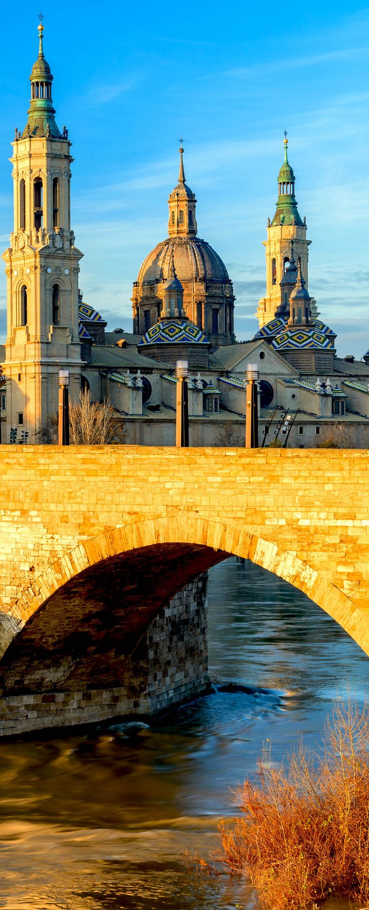 View of Basilica Pilar in Zaragoza, Spain, a Roman Catholic church which supposedly is the first church placed in Mary's name | 24 Reasons Why Spain Must Be on Your Bucket List.