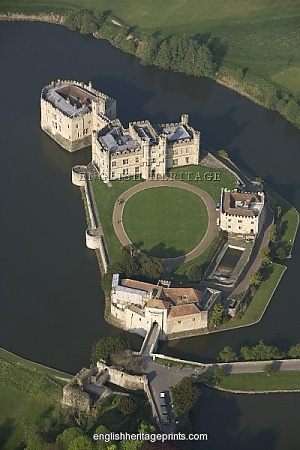 LEEDS CASTLE, Kent. UK Aerial view. First built in 1119, the castle became a royal palace for Edward I and Eleanor of Castile in 1278, who added the successive gatehouse defences of the barbican. It was later transformed by Henry VIII for Catherine of Aragon. The castle is now managed by the Leeds Castle Foundation. There is a position available for a Court Jester!! CV's should be sent to the castle, Leeds, Kent, UK, what do you do for a linving? I'm a court Jester!! Fab!