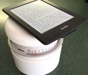 kindle ebook reader on a kitchen scale