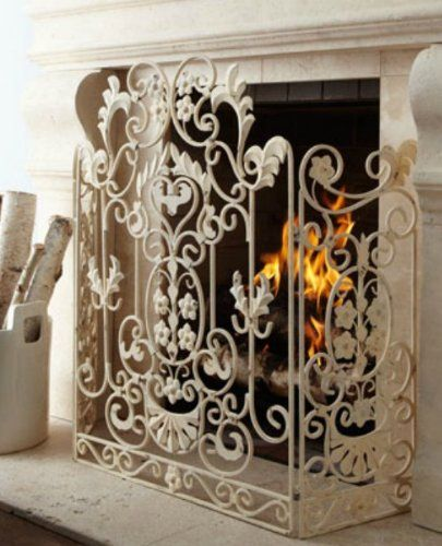 French Country White Iron Fireplace Screen by Intelligent Design, http://www.amazon.com/dp/B00A9PW45K/ref=cm_sw_r_pi_dp_PBBbrb0NRT2ZY. One of these to keep out the cat!