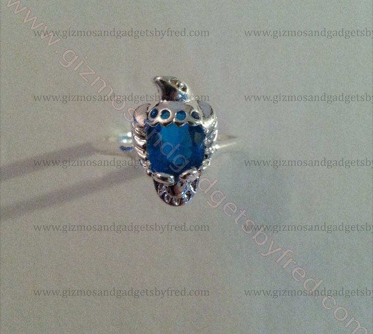Superbe Sterling Silver ring in a shape of an eagle with blue cubic zirconia. Very nice. gizmosandgadgetsbyfred.com