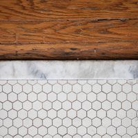 Marble thresholds are one special way to add a little extra something to the transition point between rooms in your house or just as a way to bridge the gap between two different flooring materials. Marble thresholds used to be expensive. These days, however, you can find them at any flooring store, which means you can add the beauty of natural...
