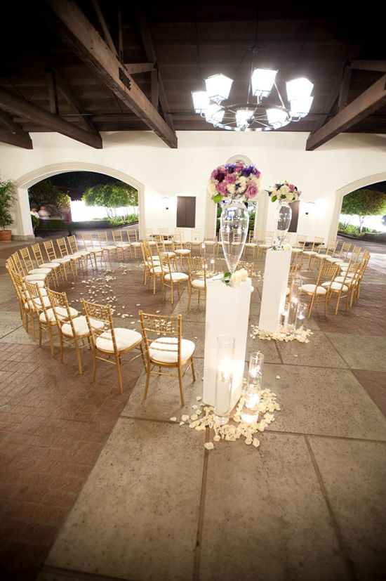 Such simple and elegant wedding seating for a small ceremony! Love the fact that the bride has to walk around the spiral and gets to see each guest so close!