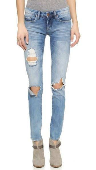 Blank Denim Distressed Skinny Jeans Blank Denim turns up the edge on classic five-pocket jeans with torn knees and whiskered details. The straight legs can be rolled up for an additional way to style.