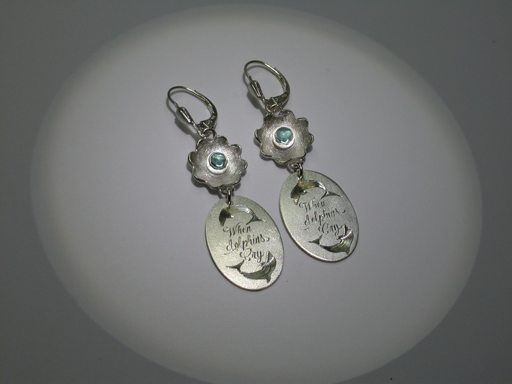 The eyes of my friends daughter are too blue to be true and she loves dolphins... Silver earrings with topazes and engravings.  Inemoni