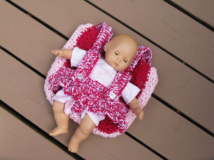 Backpack doll carrier.  This backpack allows your child to bring along the favorite friend anywhere they go.  The backpack portion is fully lined so none of their treasures will fall out.  Custom made by Your Cup of Tea Crochet.